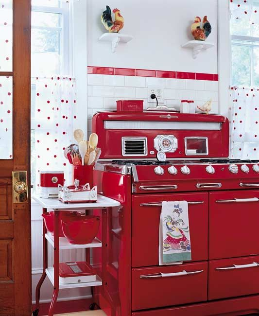 Love the deep fire engine red at work in this wonderful vintage filled kitchen. #home #decor #kitchen #stove