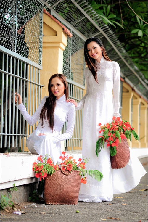 I love the white Ao Dai...so simple yet elegant.