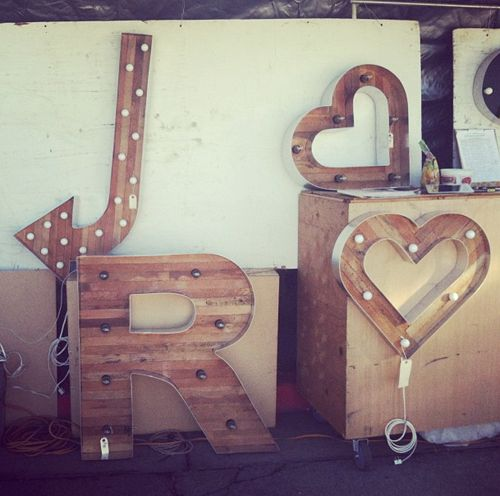adore these flea market finds: these old signs are great for big empty walls