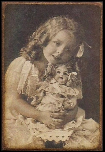 Little girl with doll