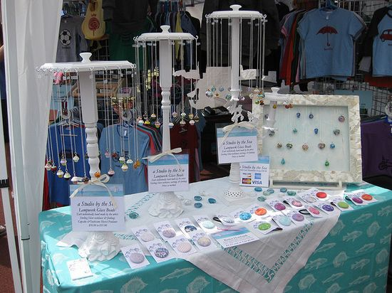 Jewelry Display by A Studio by the Sea - nice use of candlesticks as the base for necklace carousels!