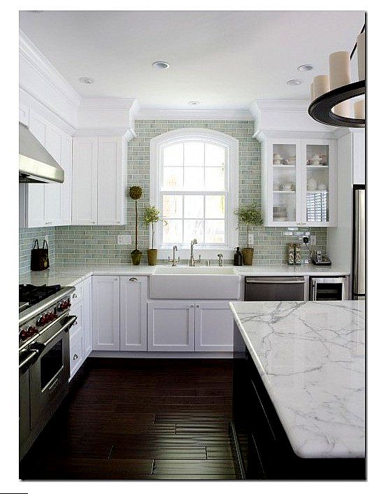 White cabinets, marble counter tops, gray subway tile, dark floors..perfect!