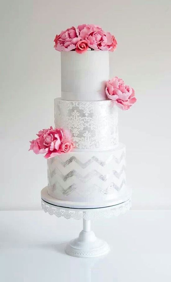 beautiful silver and white wedding cake with pink accent flowers