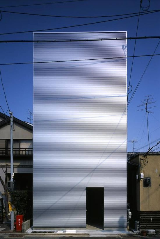 Native architects Alphaville architects Co. ltd designed a long, narrow house in Japan which avoids windows on the front and back - instead V-shaped grooves on the sides provide natural light for internal spaces: www.archello.com/... #Architecture #Design #japan #japanese #kyoto