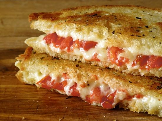 Grilled tomato and cheese with herb butter from a website devoted to all things grilled cheese!