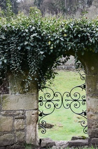Gated archway, cascading greenery