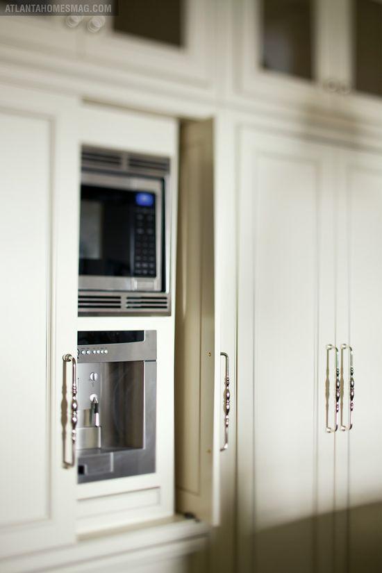 Pocket door cabinets, hidden appliances