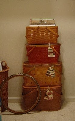 love a stack of old picnic baskets