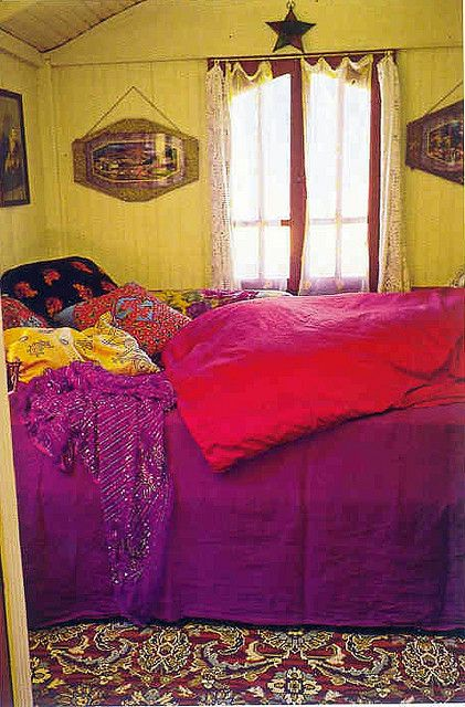 colorful comfy bedroom... love the compliments yellow and purple