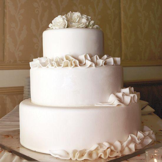 The wedding cake mimicked the cascading ruffles of the bride's gown. Photo: Edyta Szyszlo.