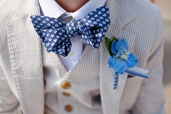 child's suit with dark blue sailboat bow tie and light blue boutonniere - preppy New York Sagamore resort wedding photo by New York wedding photographer Tracey Buyce
