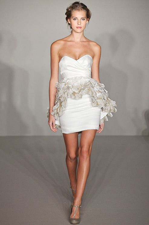 A short #wedding dress with a peplum for the reception