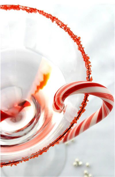 Christmas Cocktail recipes:    Candy Cane Martini (pictured)  1½ ounces vanilla vodka  ½ ounce peppermint schnapps  1 ounce club soda  crushed candy canes for garnish  / click for more recipes