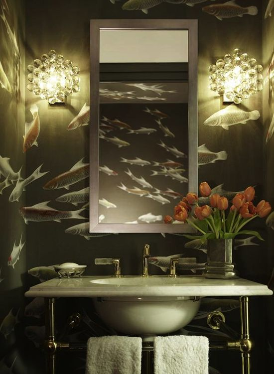 A school of fish create drama and movement in this elegant bath by Katie Ridder. The wallcovering by de Gournay is hand painted on Edo Night silk.