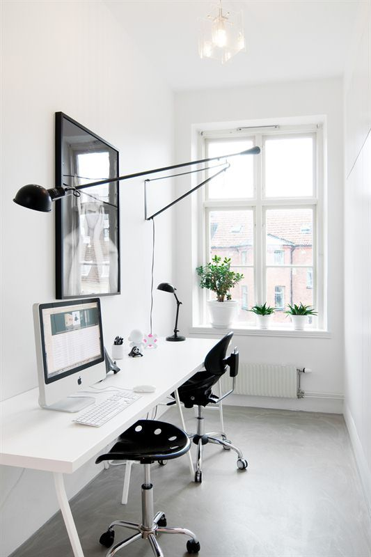 Simple, clean, serene and crisp white home office... I would love to have this as my workspace!