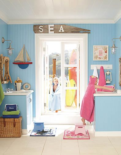 This bathroom is perfectly nautical with access to the beach. @Vicki Snyder Barn Kids