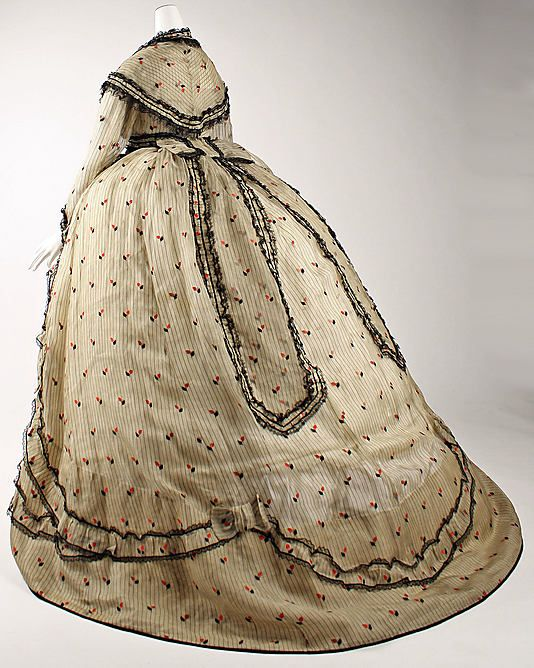 Visiting dress, ca. 1866. I love the little pops of red.