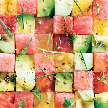 A summery salad of watermelon, avocado, tomato and cucumber.         Tomato and Watermelon Salad Photo  at Epicurious.com
