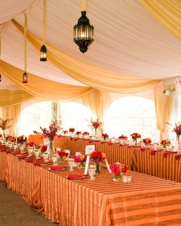 Love the hanging lanterns and the rich fabrics in this reception tent