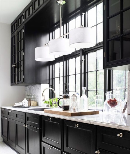 light fixture over sink and extra wide windows, glass front on upper cabinets