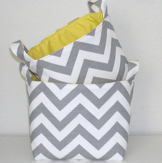 gray and yellow kitchen ( Laundry room decor) could hold rolled towels)