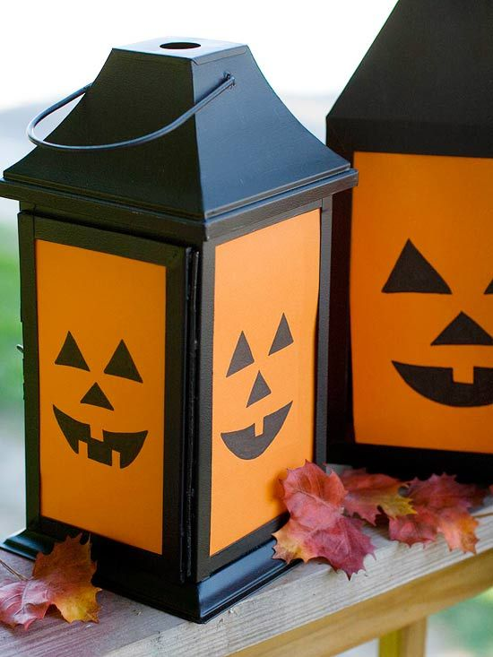 Cut out pumpkin faces on cardstock to make these cute Halloween luminarias. More spooky crafts: www.bhg.com/...
