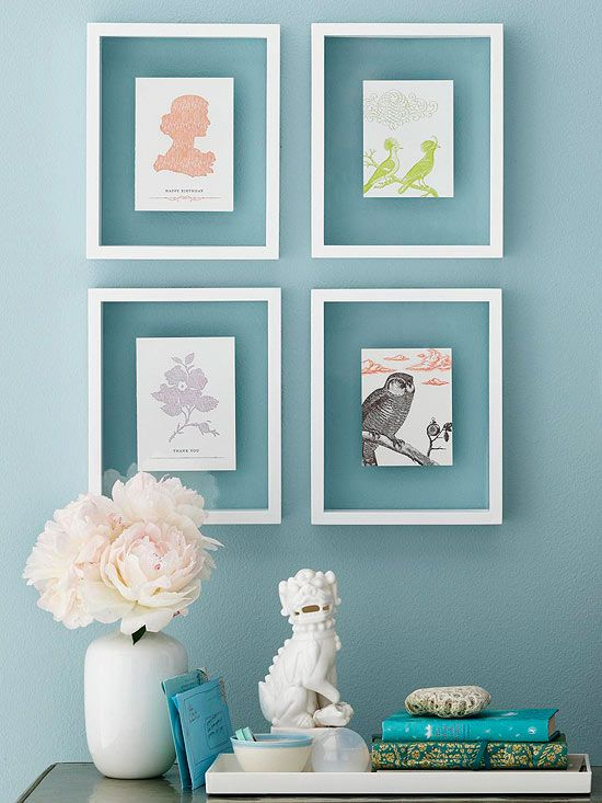 Put pretty vintage cards on display with simple white frames. More inexpensive decorating ideas: www.bhg.com/...