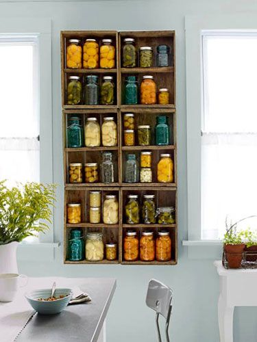 Old blueberry crates to make a ruggedly good-looking shelving unit for your kitchen. #decorating