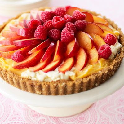 This frozen fruit tart is filled with a blend of low-fat vanilla ice cream and mango sorbet.