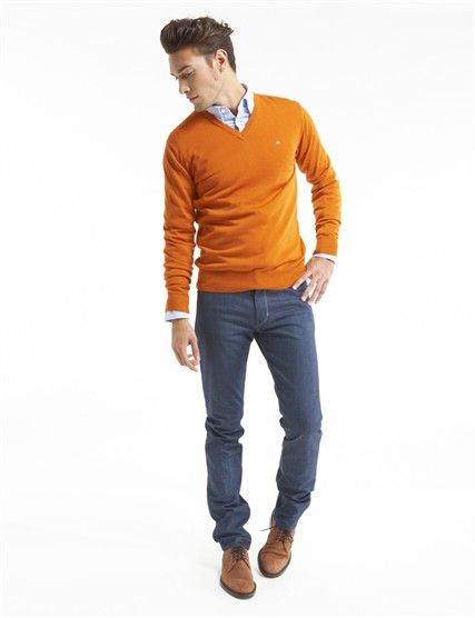 My personal opinion is that men shouldn't be afraid of adding a little color. One piece, like this great muted orange sweater looks fantastic!