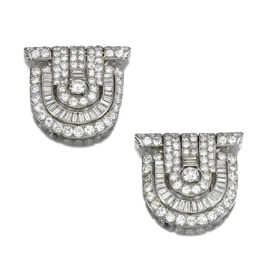 PAIR OF DIAMOND DRESS CLIPS, CARTIER, 1930S Each of Odeonesque open work design set with circular-, single-cut and baguette diamonds, each signed Cartier London, accompanied by a case, Cartier, London.