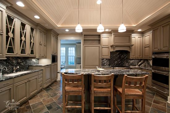 Modern kitchen with stone counters.