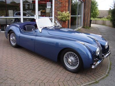 1952 Jag XK 120 OTS Roadster. Classic sports cars like this can be fun to drive but are also excellent investments.