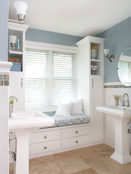 We love the cozy window seat in this open bathroom! More bathroom renovations on a budget: www.bhg.com/...