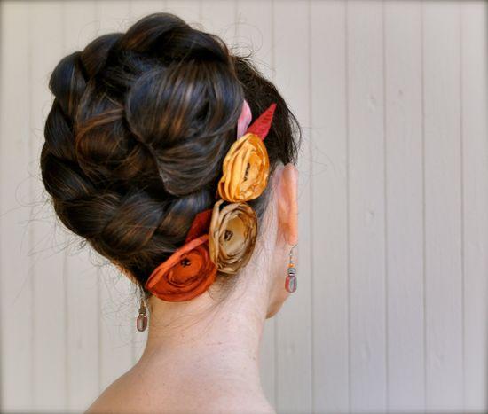 Rust, saffron and golden brown flower hair clips on a satin or velvet headband ribbon. Fall weddings bridesmaid.. $27.00, via Etsy.