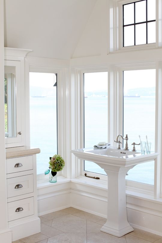 Love the corner windows and lovely pedestal sink ~ Sophie Burke Design
