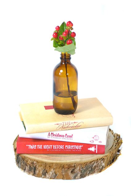 Custom cover book trio with amber glass bottle on wood base