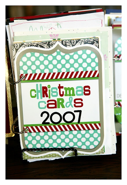 {I'm doing this! Send me your cards!!!!} a neat way to store Christmas Cards - put them together in a book. Free cover printables are included