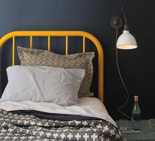 dark walls/yellow bed