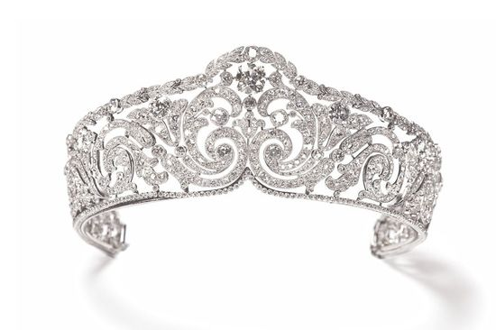 Cartier's :  Adopted as an insignia of royal power, the tiara evolved over the centuries into increasingly precious versions that were symbols of the high rank of the wearer. It returned to favour in the 19th century and continued to exert its fascination until the end of the First World War. Cartier's first large tiaras were recorded at the turn of the 20th century. a perfect match for the requirements of Belle Époque fashion
