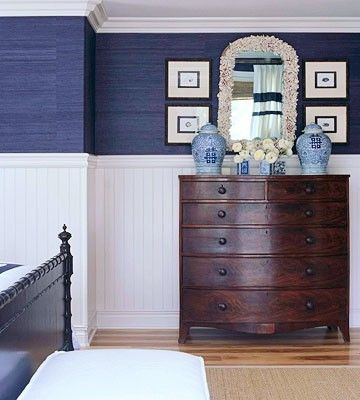 Navy and white bedroom with navy grasscloth and wainscoting