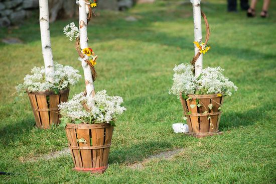 A gorgeous ceremony. Loving the garden decor! {David Walters Photography}