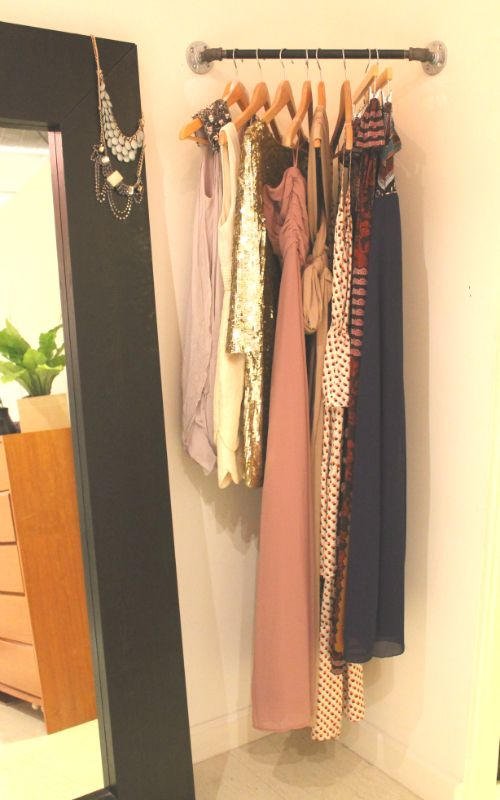Corner rod for planning outfits/what to wear the next day. Super clever for those wasteful corner spaces! You could put a corner shelf above and plan your shoes and jewelry too!
