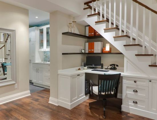 Home office design utilizes the place underneath the stairs. So clever!!