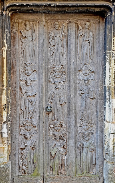 Apostle's door, Berkeley Castle. The castle doors were made in Holland and imported into England during the 16th.century. Known as the Apostle's door, originally there were twelve carved figures but the doors were too big to fit the castle entrance so were reduced in size losing three of the figures during the process.