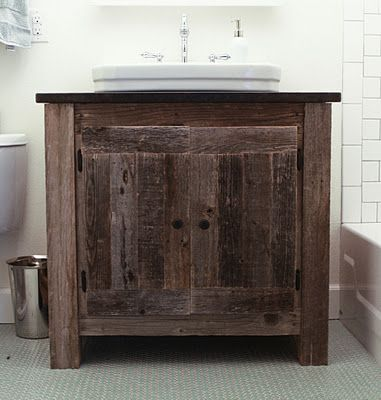 Reclaimed wood vanity with vessel sink.
