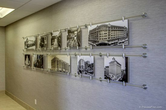 custom art display shows 100 years of companies history #office #lobby #interior design #san diego office design #art