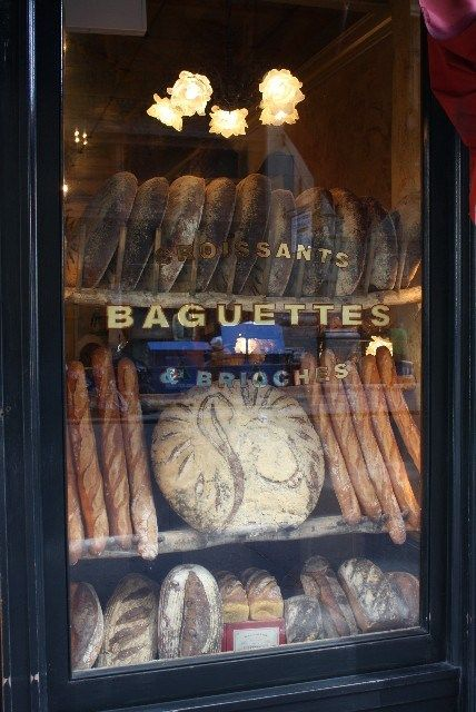 Bread displayed in store front windows