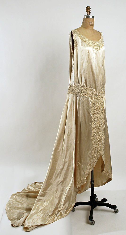 Embroidered satin wedding dress, American, ca. 1928. Worn with satin chevron cap with flowers and net veil.