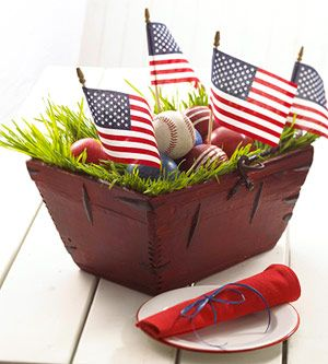 Summertime nostalgia: American flags, baseballs and croquet balls. More on this and other red, white and blue centerpieces: www.midwestliving...